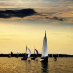 Sailing home through all of the sailboats at sunset