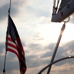 American Flag at the helm of the schooner in the clouds