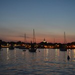 The Harbor at dusk with all of the lights and moored boats