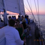 Guests enjoying a beautiful sunset and cruise on the schooner