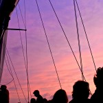 Purple sunset sky above the sails