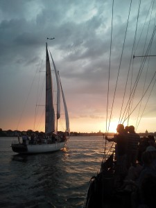 Great photo as Woodwind II passes us at sunset in Annapolis