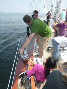 Fisherman trim team adjusting sails on Schooner Woodwind