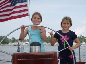 Alyssa and Natalie at the helm of Schooner Woodwind