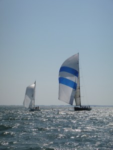 Donnybrook (80+ foot race boat) sailing through the fleet of Hospice Cup