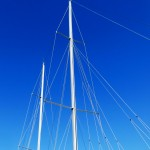 Masts and rigging against brilliant blue sky