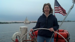 Mary at the helm.  Stanley Norman in background.