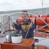 Captain Corbin steering the Schooner Woodwind