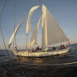 One schooner reflecting shadows on the other schooner