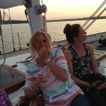 Guests enjoying beverages and a sunset sail