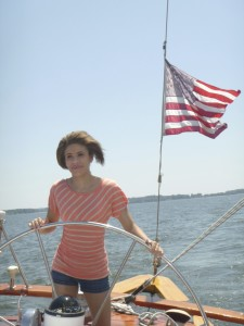 Makayla at the wheel of the 74' Schooner Woodwind