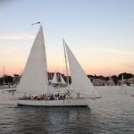 Looking at one schooner through another schooners sails