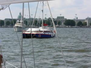 This cruising catamaran is at anchor.