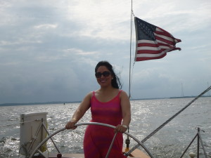 Dayana at the wheel of the Schooner Woodwind