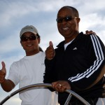 Guest and captain giving two thumbs up while sailing the Woodwind