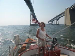 Michelle at the wheel of the schooner Woodwind II