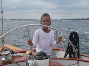 All smiles.. showing Capt. Mickey the proper way to steer the boat