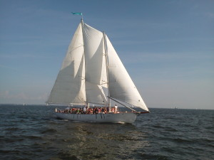 Schooner Woodwind against blue skies and blue waters full of guests