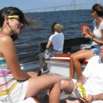 Guests enjoying snacks and a sail on a sunny day