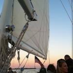 Guests enjoying a sunset sail