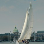 Schooner under sail with USNA Chapel Dome in back ground