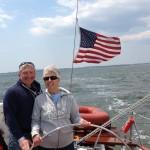 Couple steering the schooner on the Chesapeake Bay