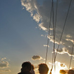 Guests enjoying a sunset over the bay from the schooner
