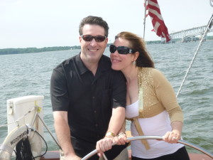 The newly engaged couple Dee and Dave sharing the wheel on the Schooner Woodwind