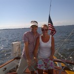 Man and women steering the schooner together