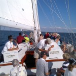 Guests enjoying a breezy sunny sail on the schooner