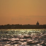 Yellow sky reflecting on waters along Annapolis City skyline