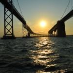 Sailing under the Bay Bridge at sunset