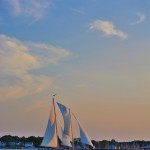 Blue pastel colors framing the schooner at sunset