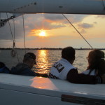 Two couples enjoying a sunset from the schooner while sailing