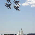 Four Blue Angel jets soaring over the schooner and water