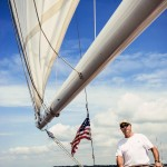 Blue skies and fair sails with the captain at the helm