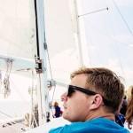 Man in sunglasses enjoying his sail