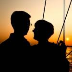 Couple enjoying sail at sunset