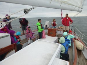 At the wheel of the Schooner Woodwind