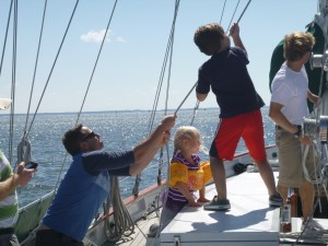 Wyatt and Caroline helping dad with the stay sail