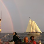 Rainbow over both schooners sailing together