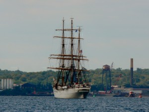The barque Eagle is heading away from us under power.