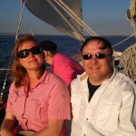 Happy guests aboard the schooner sailing on a sunny day