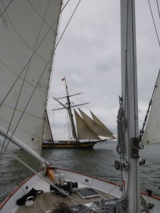 Pride of Baltimore setting her sails off the bow of Woodwind II