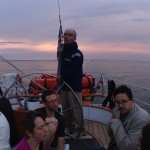 Guest on a cloudy sunset sail