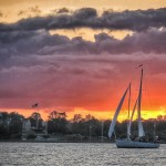 Picture of the schooner in all grey except the sunset in brilliant Orange