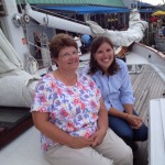 Two ladies smiling just getting ready for their sail on the schooner