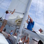 Guests giving a hand with the sails