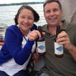 Two guests enjoying Port City beverages on a sail
