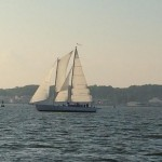 Schooner on a blue horizon in full sail